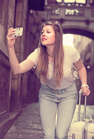 Young woman is taking photo on her phone while journey.