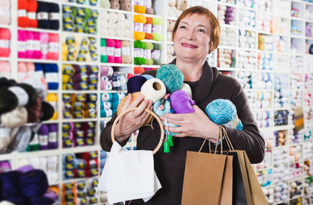 Mature woman with accessories for needlework after shopping Stock Photo