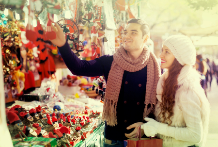 Happy married couple at Catalan Christmas market  Banco de Imagens