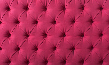 background with bright pink upholstered old-fashioned furniture textile