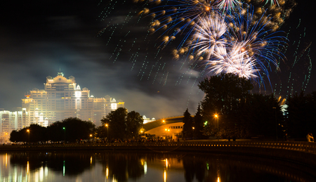 Bright fireworks performance in night sky of minsk