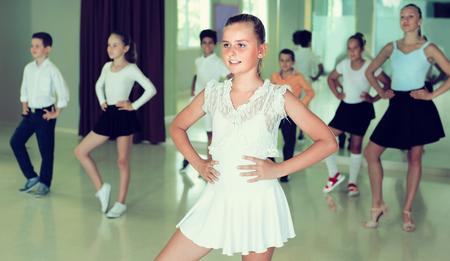 Positive kids are dancing rock-n-roll in class.