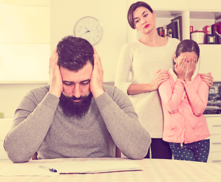 Young family having difficulties with paying utility bills and rent