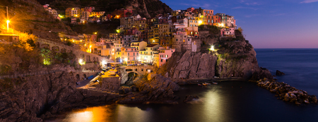 The colorful houses of Manarola, La Spezia in evening from sea view  at Italy Stock Photo
