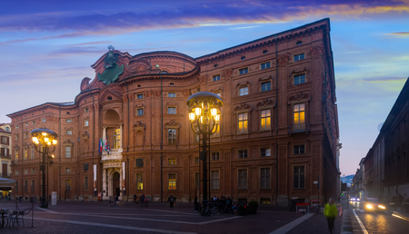 Impressive rounded facade of historic Palazzo Carignano building in evening time, Turin, Italy