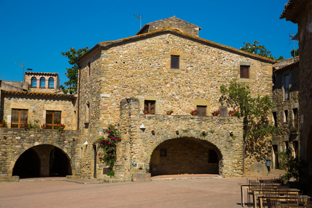 Edifices on main square in the Catalan village of Monells, Spain Stock Photo
