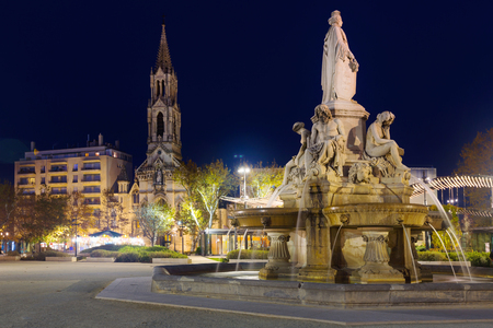 Image of Fontaine Pradier in Nimes at night illuminated, France
