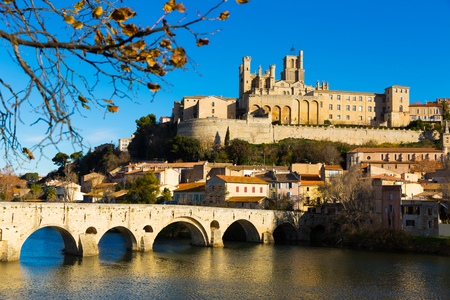 Arched Old Bridge over Orb river and medieval cathedral of Saint Nazaire in Beziers