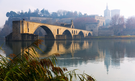 Pont Saint-Benezet and Avignon Cathedral in winter morning, France 写真素材
