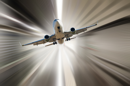 Passenger aircraft flying in sky in divergent glar sunlight Stock Photo