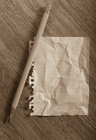 Empty crumpled page torn from notebook lying on wooden surface Stok Fotoğraf