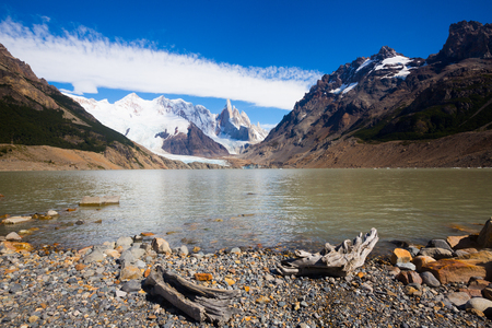 Mountain lake Laguna Los Tres at foot of Cerro Torre and Fitz Roy on sunny day, Santa Cruz, Argentina, South America