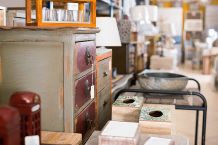 Image of modern furniture shop with wooden chest of stylish old beautiful drawers