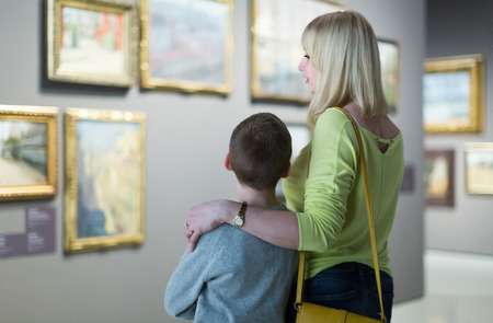 positive germany  mother and son looking at paintings in halls of museum Stock Photo