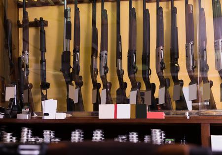 Gun shop interior with rifles on showcase Stock Photo