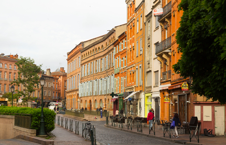 TOULOUSE, FRANCE - MAY 12, 2017: Streets of Toulouse called pink city because of color of brick