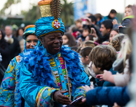 BARCELONA, SPAIN –  JANUARY 5, 2017: King Baltasar with entourage takes letters from children. Barcelona, Spain