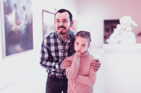 Father and daughter exploring religious art in museum Stock Photo
