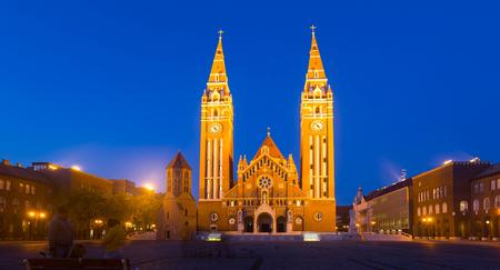 Impressive illuminated Cathedral of Our Lady on Dom square, Szeged, Hungary Stock Photo