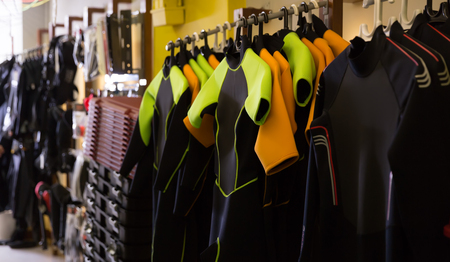 Image of the different new costumes for diving in the sport shop