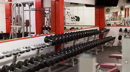 Interior of modern light gym with equipments