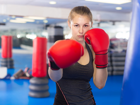 Portrait of young italian woman who is training in box gym.