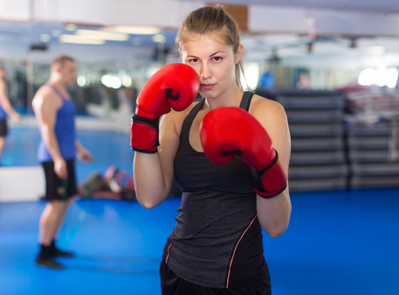 Portrait of young germany woman who is training in box gym. Stock Photo