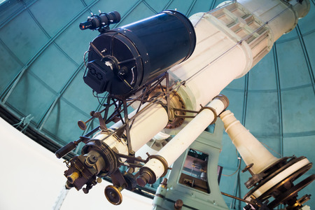 modern large telescope in observatory with windows closed  Stock Photo