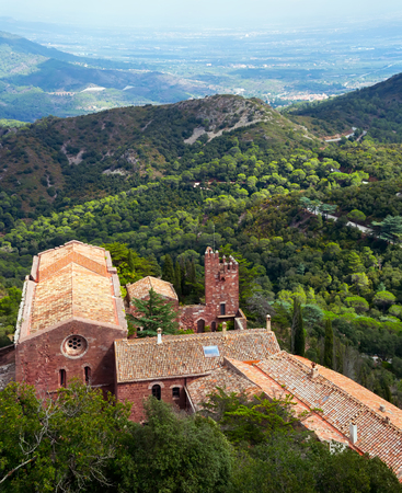Castell de Escornalbou lost in mountains of Riudecanyes, Spain