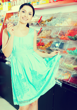Portrait of  girl  with lollypop at candies shop
