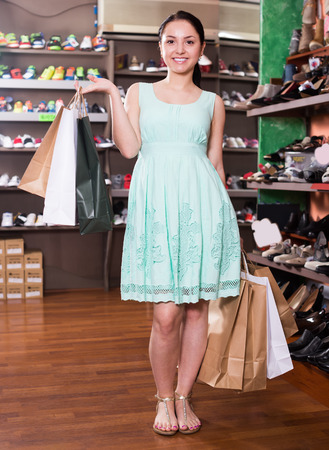 Smiling female customer is demonstrating purchases in store Stock Photo