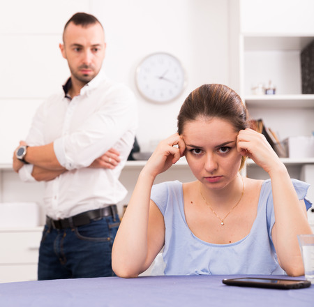 Woman is upset because she quarrel with her husband at home.