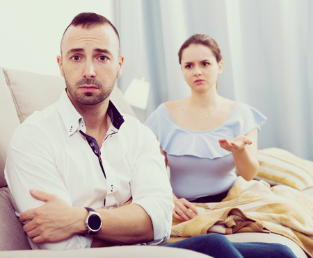 Man is upset because he quarrel with his wife at home.