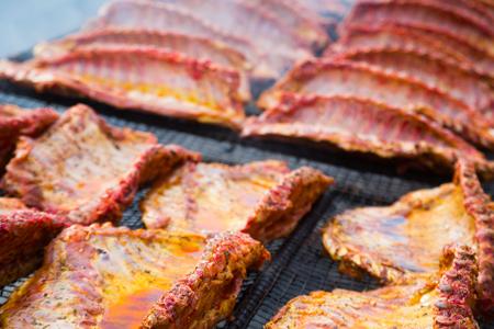 Image of tasty pork ribs preparing on grill brazier outdoors Archivio Fotografico