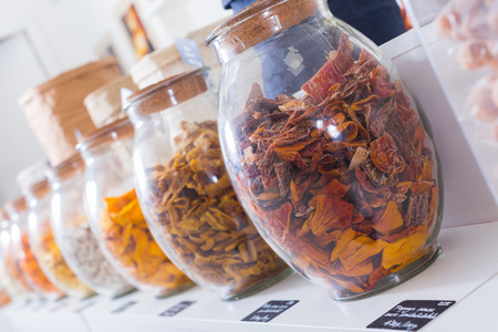 Photo of containers with dried fruits in the food store.