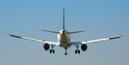 Spacious passenger airliner flying in sky towards destination Stock Photo