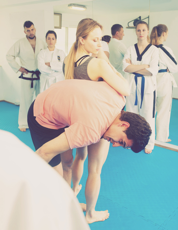 Girl learn how to use self-defense techniques in training for martial arts