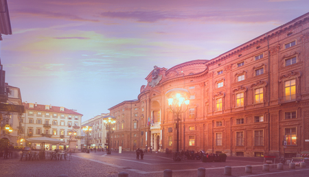 Piazza Carignano, one of main squares of Turin with baroque Palazzo Carignano at twilight