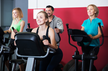 Active adults in a fitness center working out at group class Standard-Bild