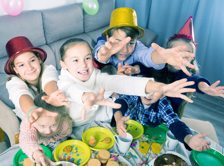 Portrait group of children having fun during friend's birthday party
