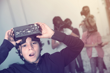 Rapturous kids are looking for way out of virtual escape room Stock fotó - 97673882