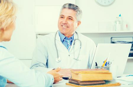 Mature professor of medicine advising his colleague on scientific issues Stock fotó