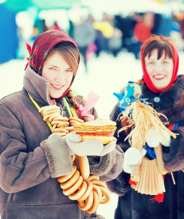 Two happy girls celebrating  Shrovetide  at Russia Stock Photo