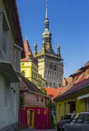 Illustration of Clock tower from streets of Sighisoara in Romania.
