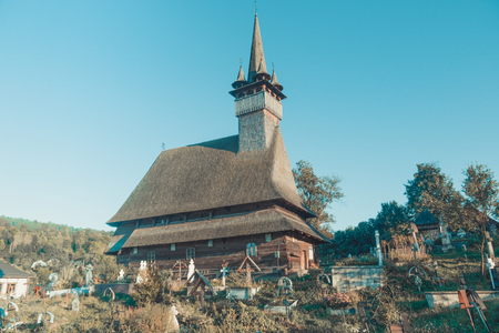 Image of wooden Biserica Sf. Nicolae in Maramures in Romania.