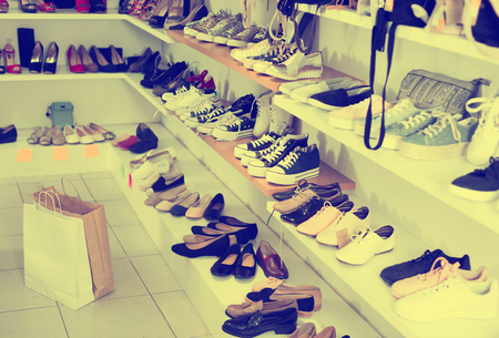 Picture of shelves with sneakers in the shoes store Stock fotó