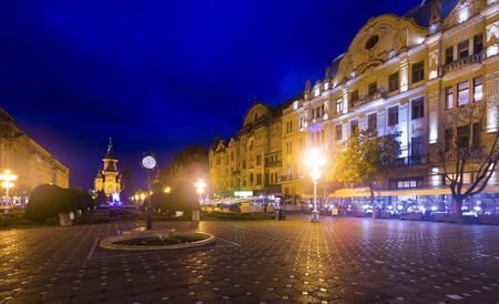 Illuminated Victoriei Square with Romanian Orthodox Metropolitan Cathedral at dusk, Romania Stock Photo