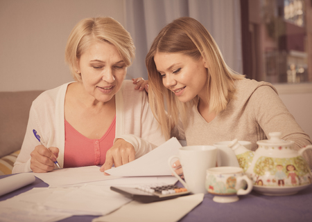Grown daughter helps her mother deal with bills and taxes