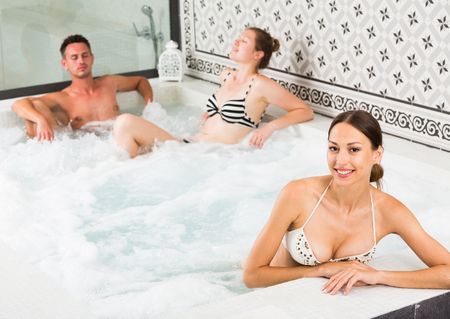 Portrait of happy girl relaxing with friends at spa, enjoying company