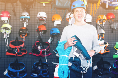 Young sportsman chooses a sports equipment in the sports shop